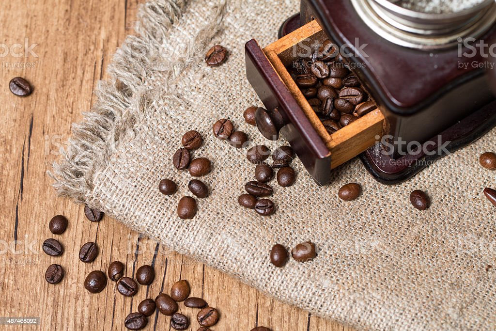Antique coffee grinder and coffee beans stock photo