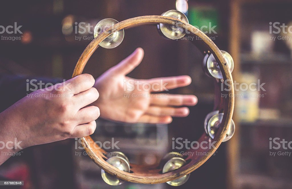 Antique collection of the wooden tambourine musical percussion. stock photo