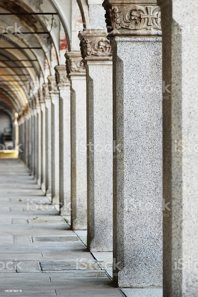 Antique colonnade in Italian cemetery royalty-free stock photo