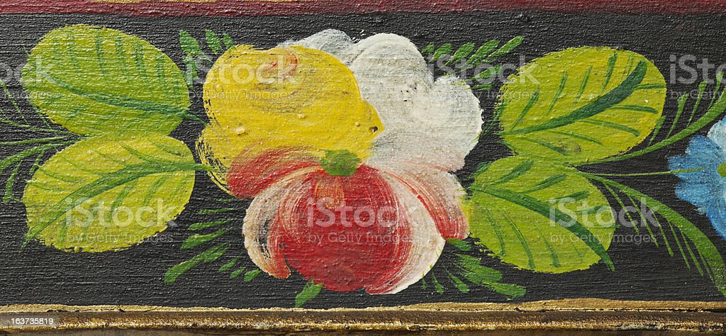 Antique, colorful painted ornate flower motive. stock photo