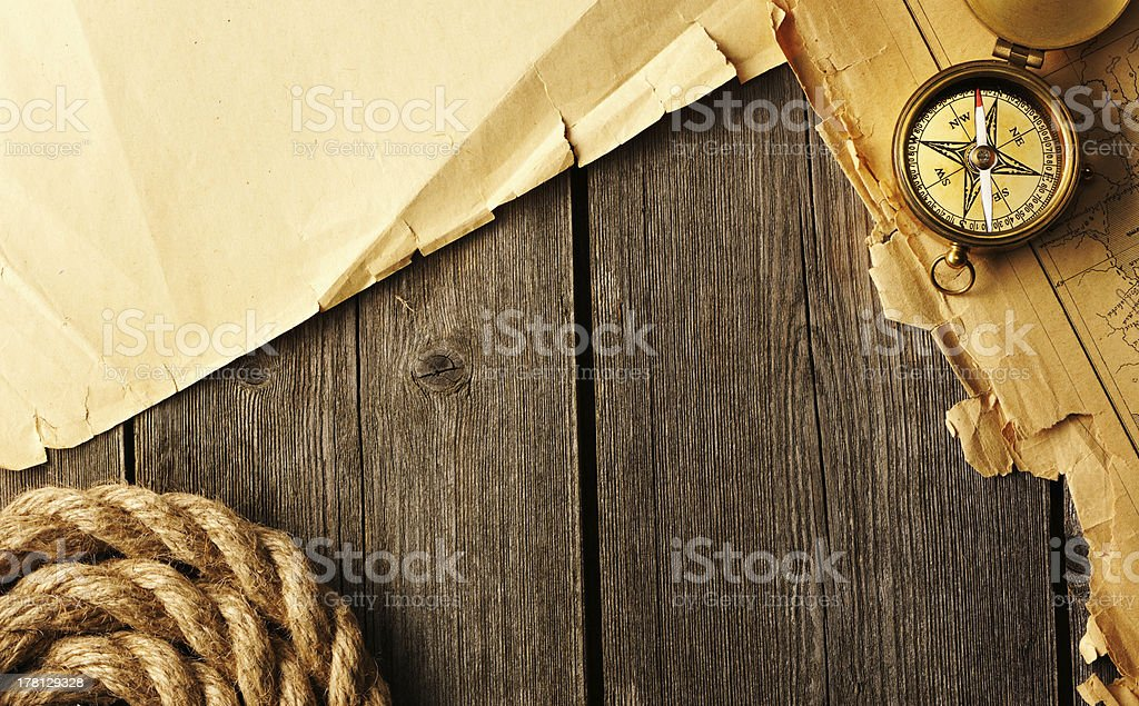 Antique compass and rope over old map royalty-free stock photo