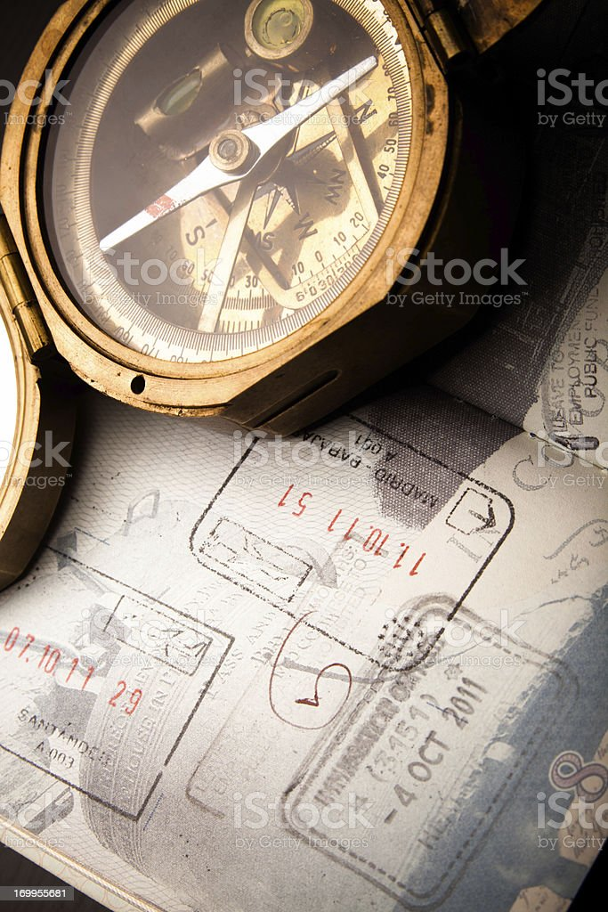 Antique Compass and Well-Traveled Passport royalty-free stock photo