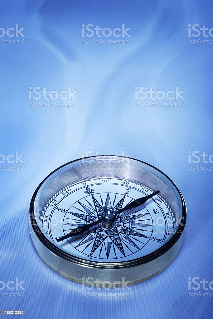 Antique Compass on Blue stock photo