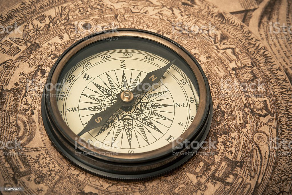 Antique Compass on Map stock photo