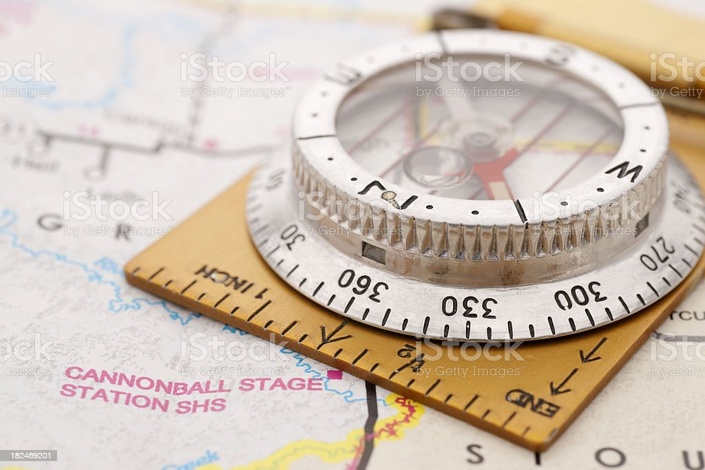 antique compass on map royalty-free stock photo