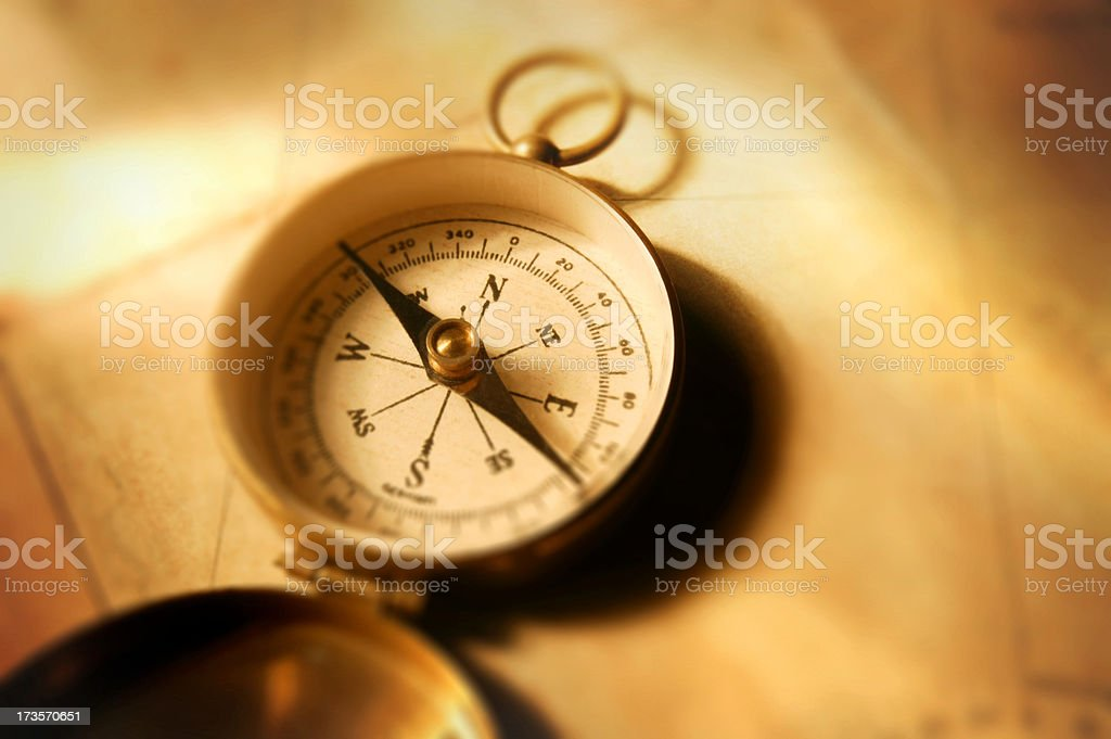 Antique Compass On Old Map Photographed  Shallow Depth Of Field royalty-free stock photo