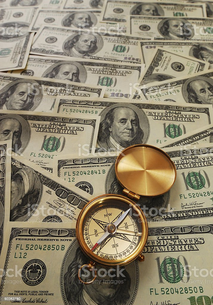 Antique compass over money royalty-free stock photo