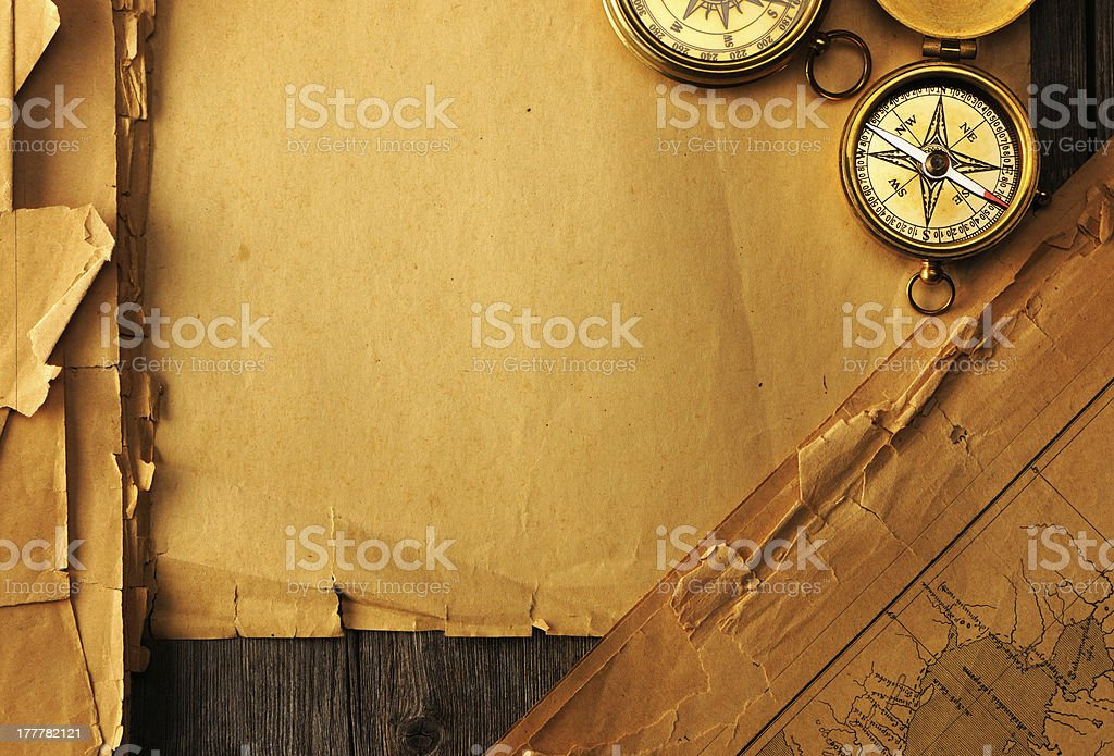 Antique compass over old map royalty-free stock photo