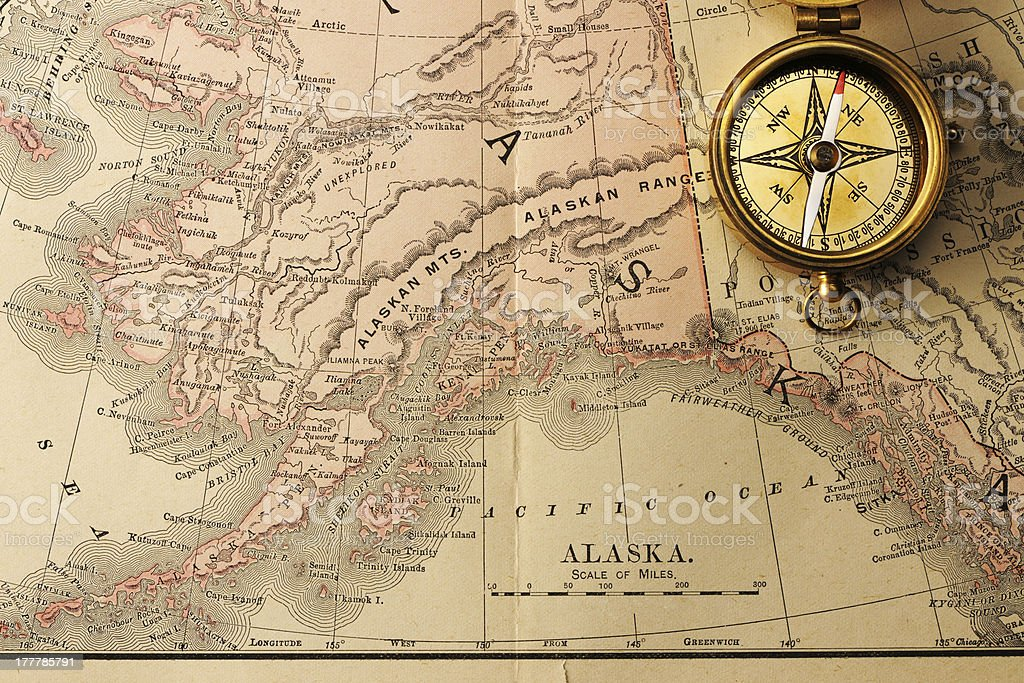 Antique compass over old XIX century map stock photo