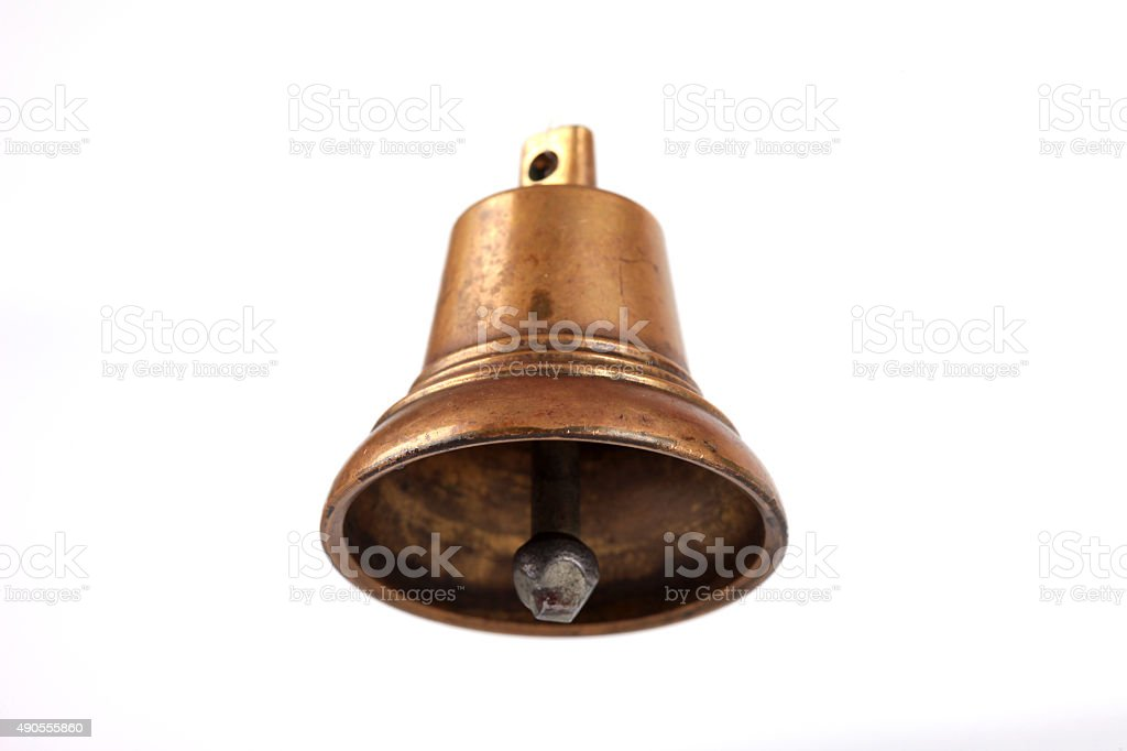 Antique copper small bell on white background stock photo