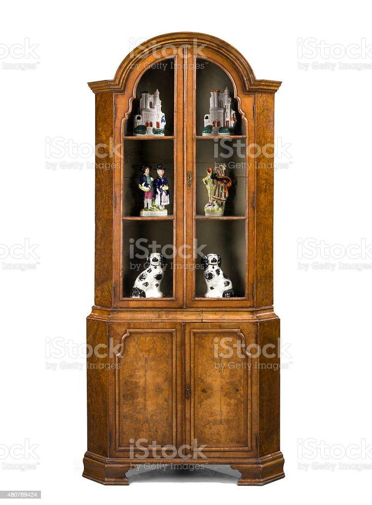 Antique corner cupboard vintage tall walnut Queen Anne design stock photo