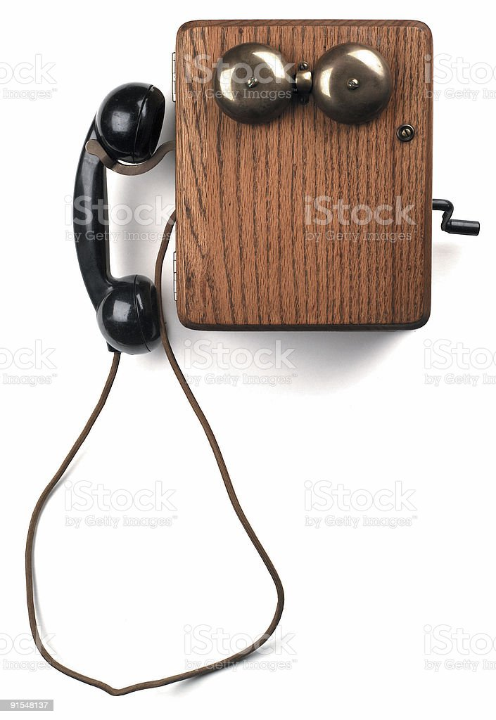 antique crank telephone on white royalty-free stock photo
