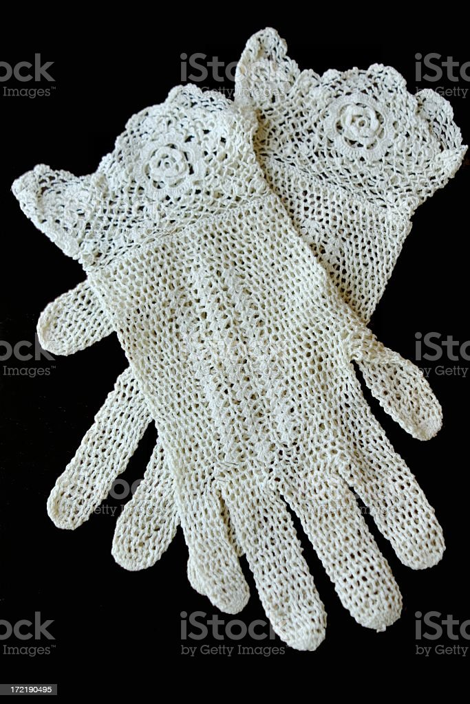 Antique Crocheted Gloves on black background stock photo