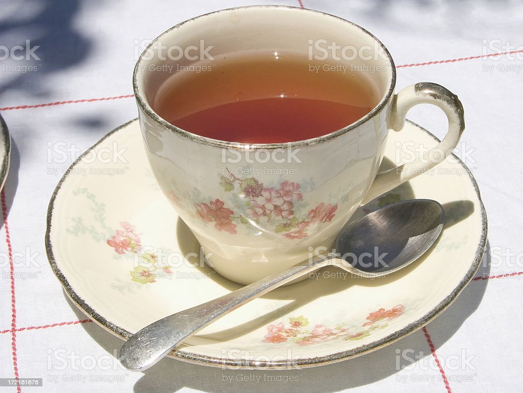 antique cup and saucer with black tea stock photo