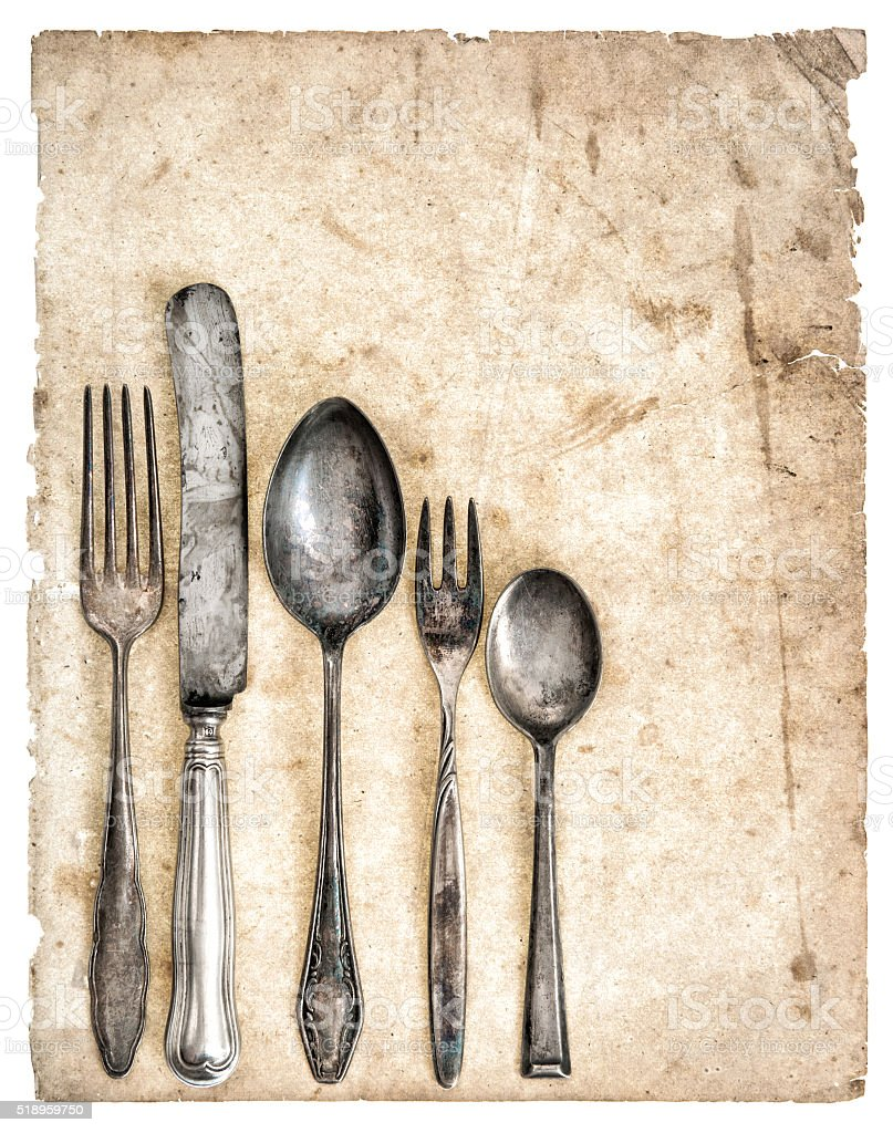 Antique cutlery and old cook book page stock photo