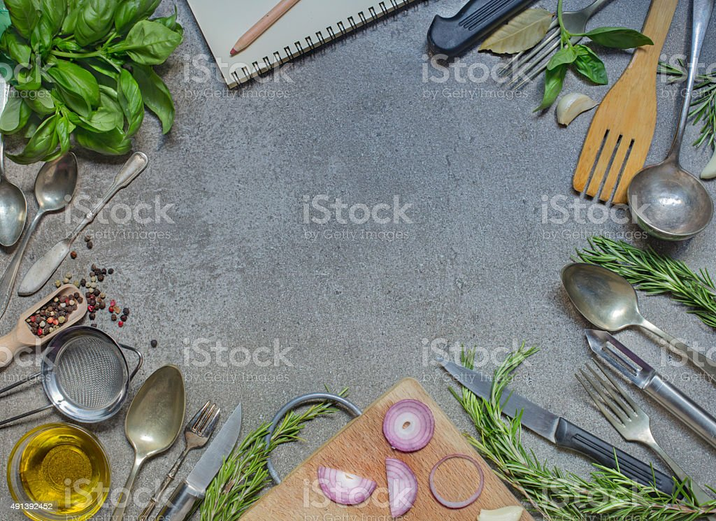 Antique cutlery with condiment, herb and olive oil stock photo