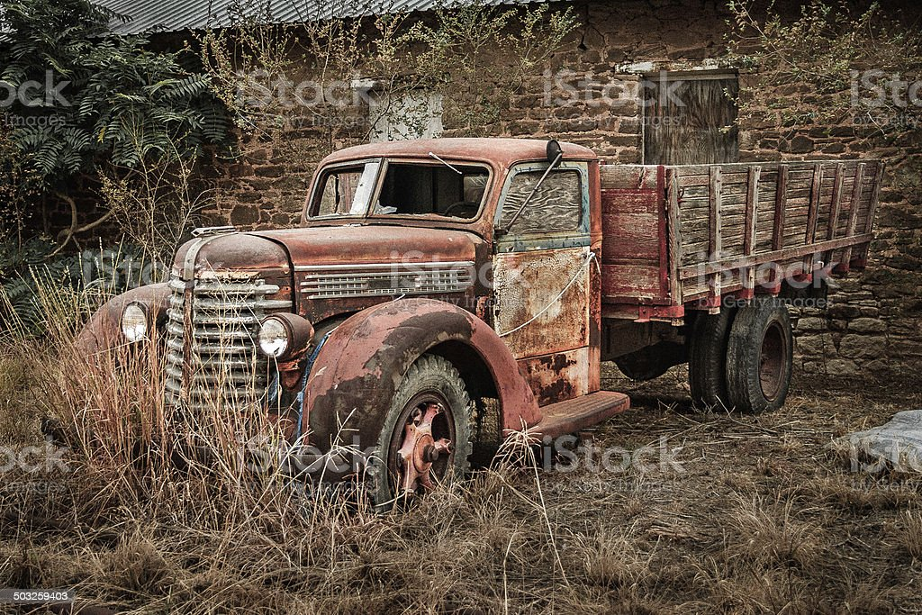 antique derelict red rusty pickup truck in Post Texas royalty-free stock photo