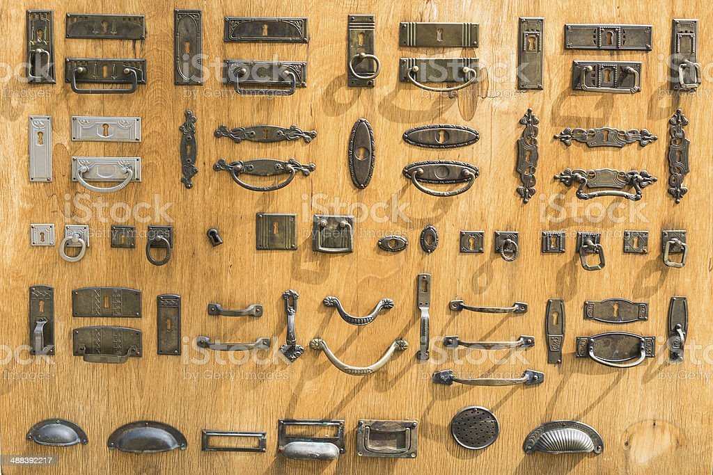 antique designed drawer handles and door fittings stock photo