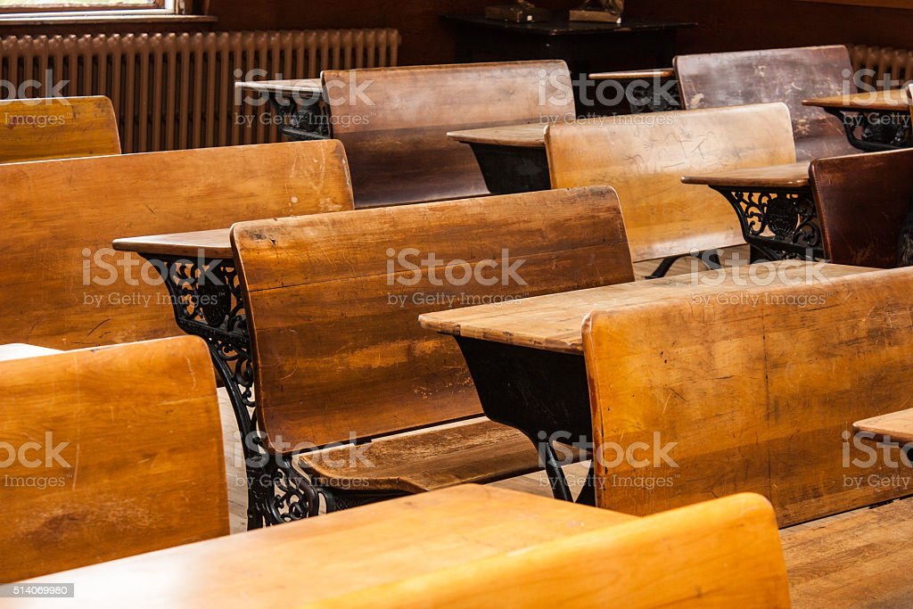 Antique desks in school house stock photo