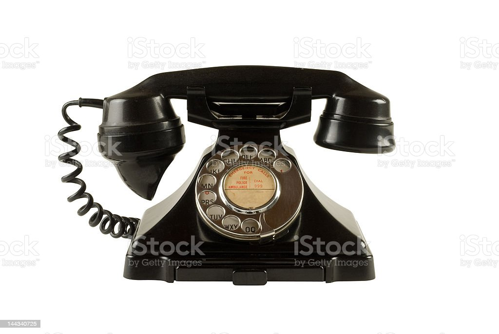 Antique dial telephone isolated on white with clipping path stock photo