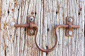 Antique Door Knocker on Old Wood Door (Close-Up)