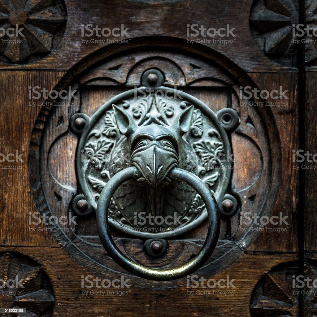 Antique door knocker shaped monster's head. stock photo