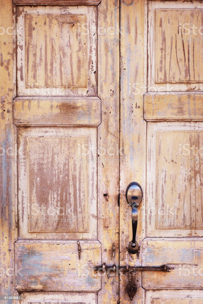 antique door with rusty latch and modern deadbolt stock photo