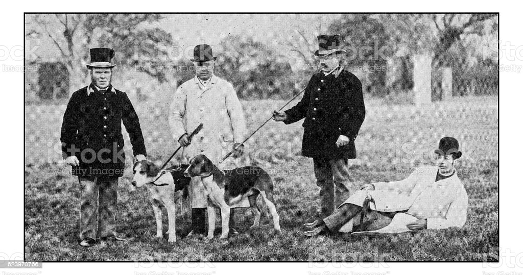 Antique dotprinted photograph of Hobbies and Sports: Men with dogs stock photo
