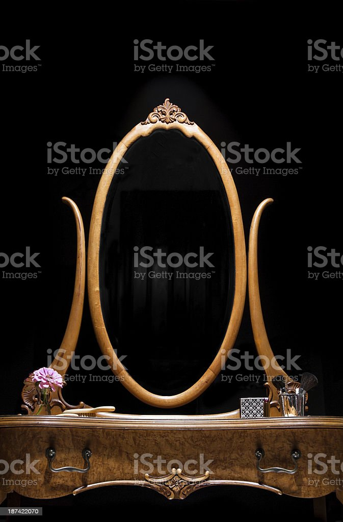 Antique dressing table with oval mirror stock photo