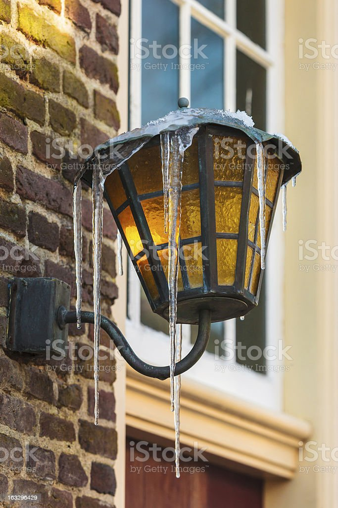 Antique Dutch lantern covered with icicles royalty-free stock photo