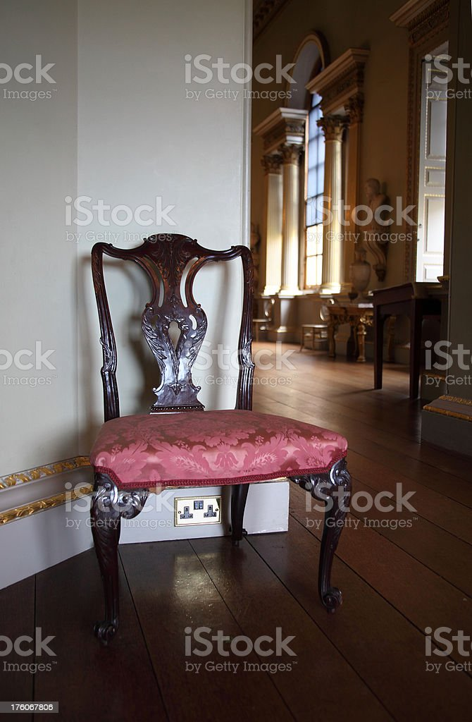Antique English chair with ornate woodwork stock photo