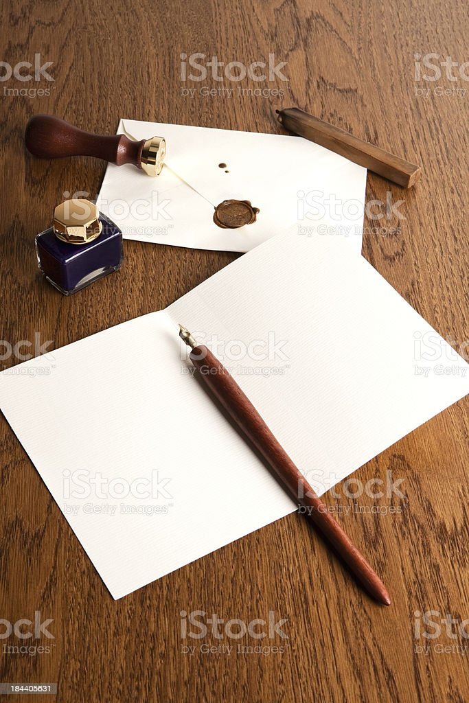 Antique fountain pen and ink on the table stock photo