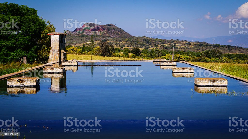 Antique Fountain with the Volcano at the backround stock photo