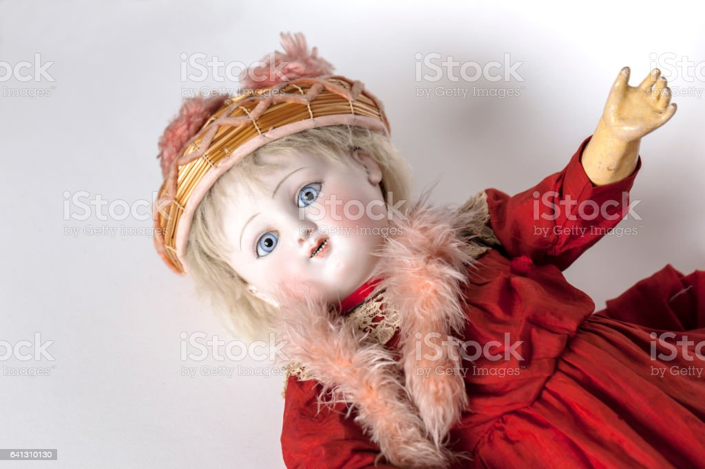 French 1880\'s doll on white background, with blue spiral threaded...