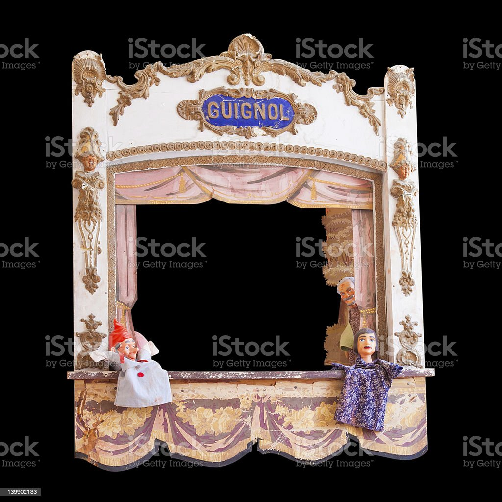 Antique French guignol isolated on black stock photo