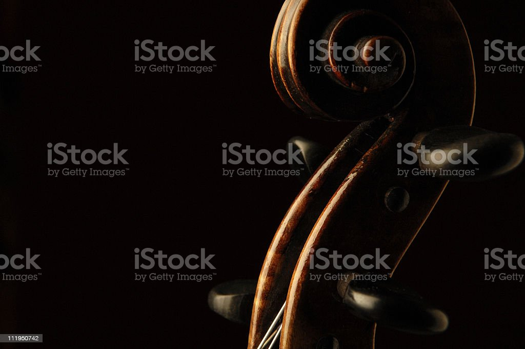 Antique French Violin Scroll on Black royalty-free stock photo
