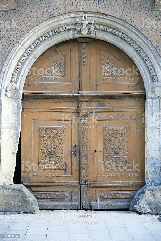 Antique gate with huge wooden doors stock photo