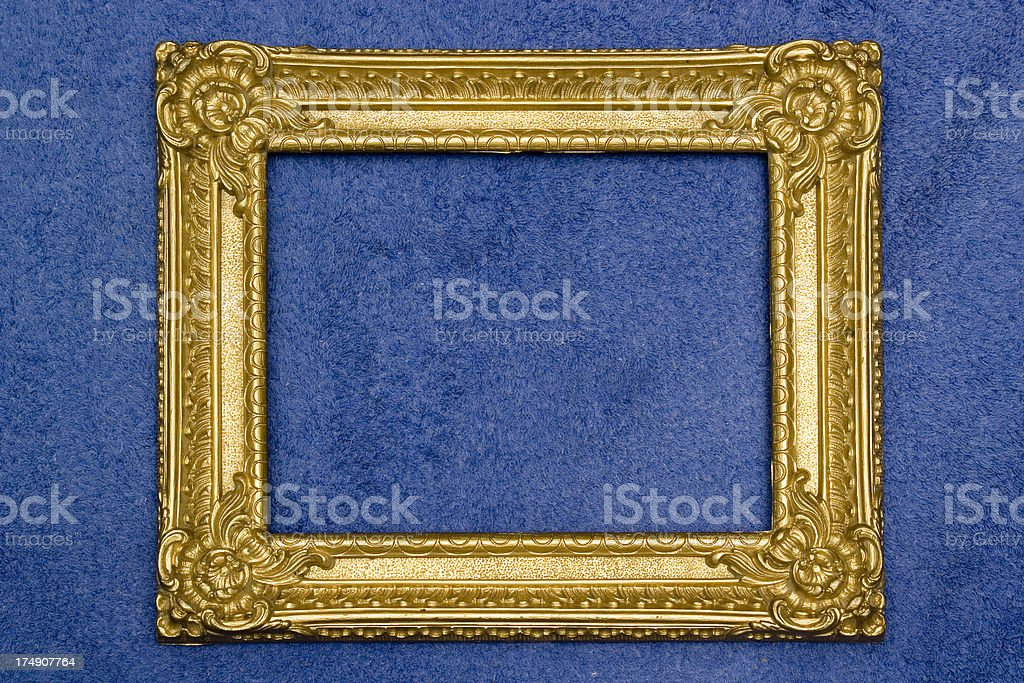 Antique Gilded frame on blue. royalty-free stock photo