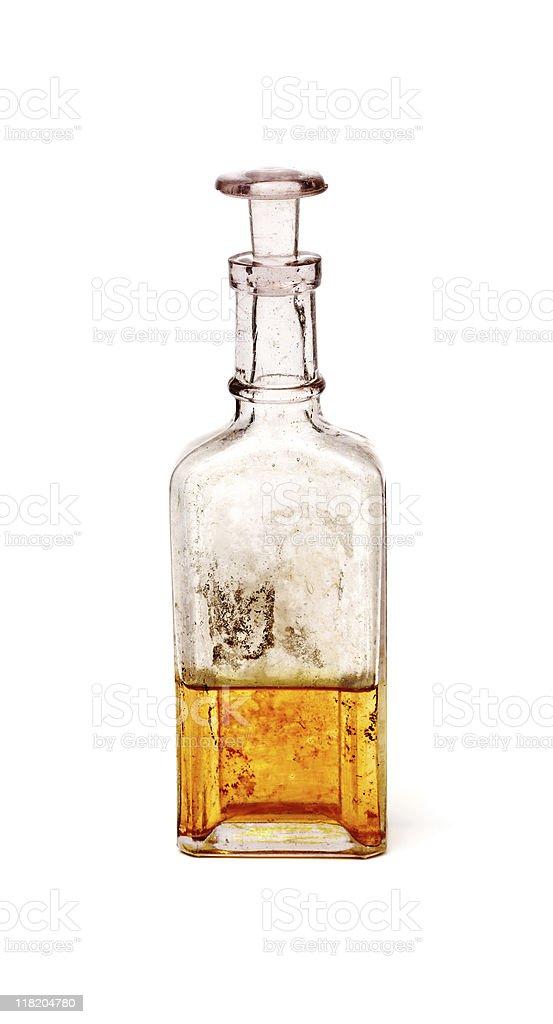 Antique glass bottle containing golden liquid stock photo