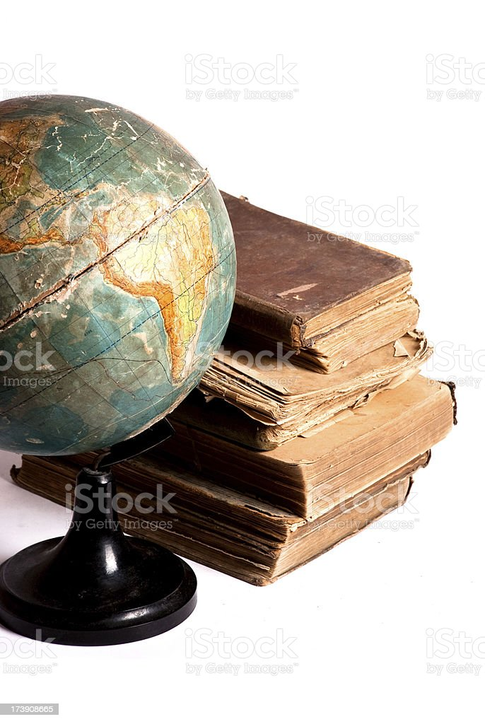 Antique globe and books stock photo