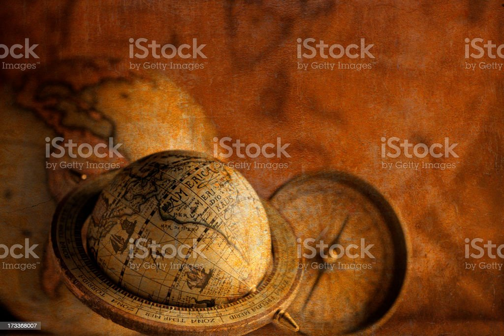 Antique Globes And Compass In Front Of Old World Map royalty-free stock photo