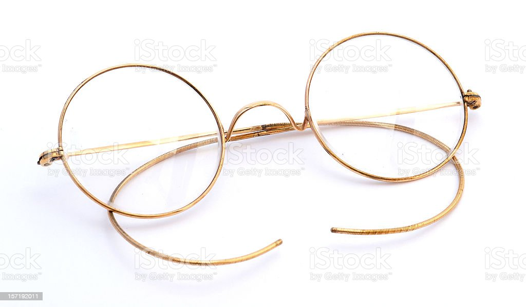 Antique gold eyeglasses royalty-free stock photo