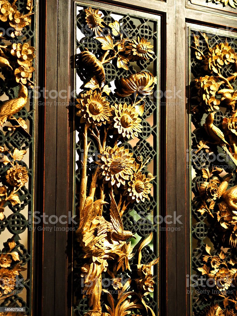 Antique gold gilded woodcarving panels in Straits Chinese home 2 stock photo