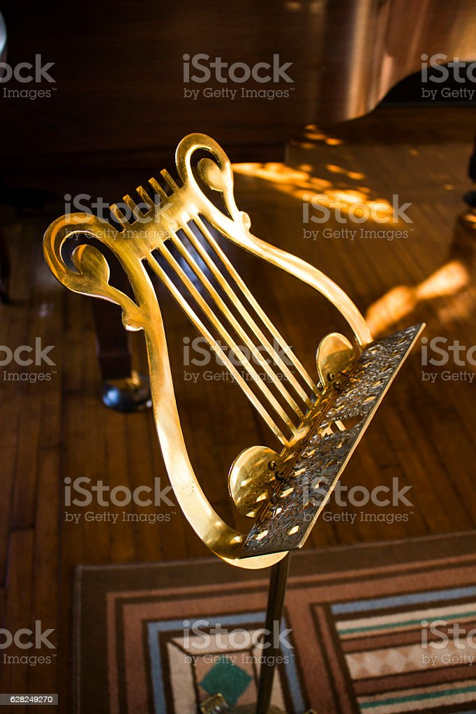 Antique gold sheet music stand stock photo