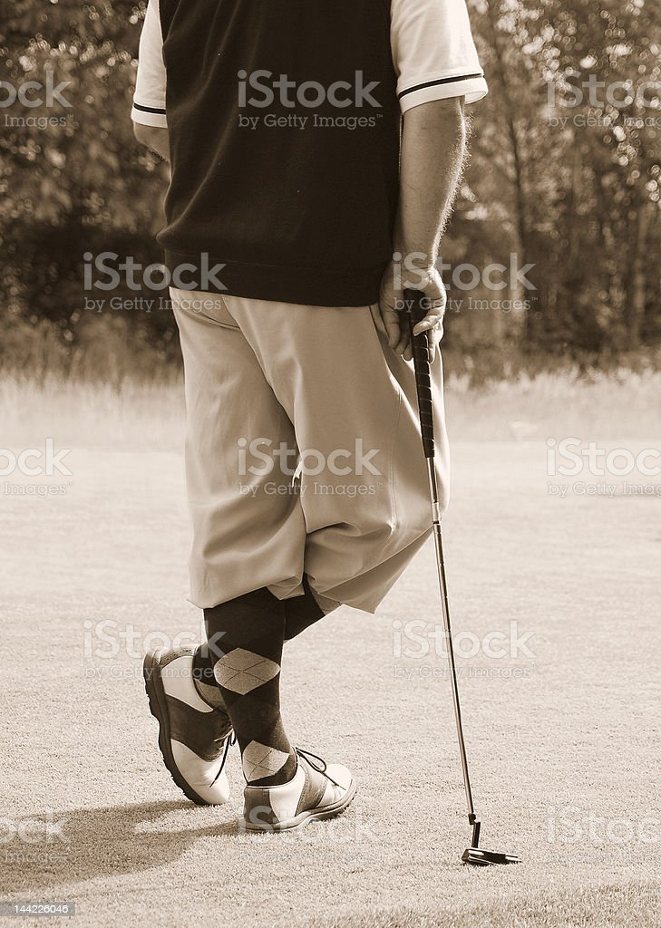 Antique golfer stock photo