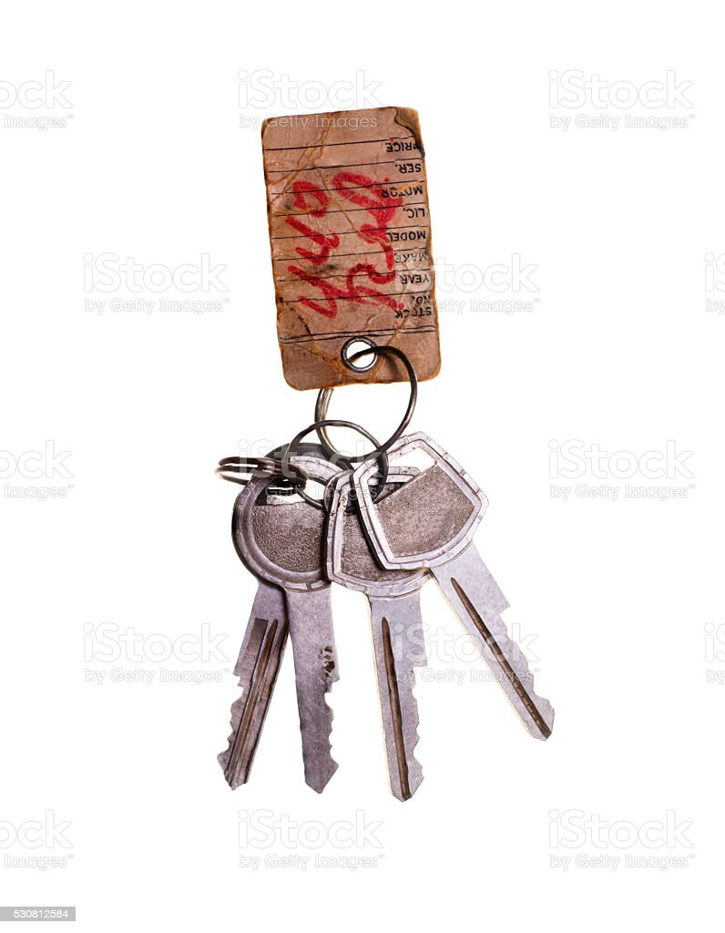 Antique Grunge  Metal Keys with Repair Tag Isolated on White stock photo