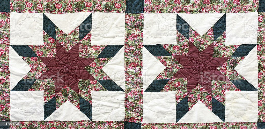 Antique handquilted star pattern.  Red, green, maroon, white. royalty-free stock photo
