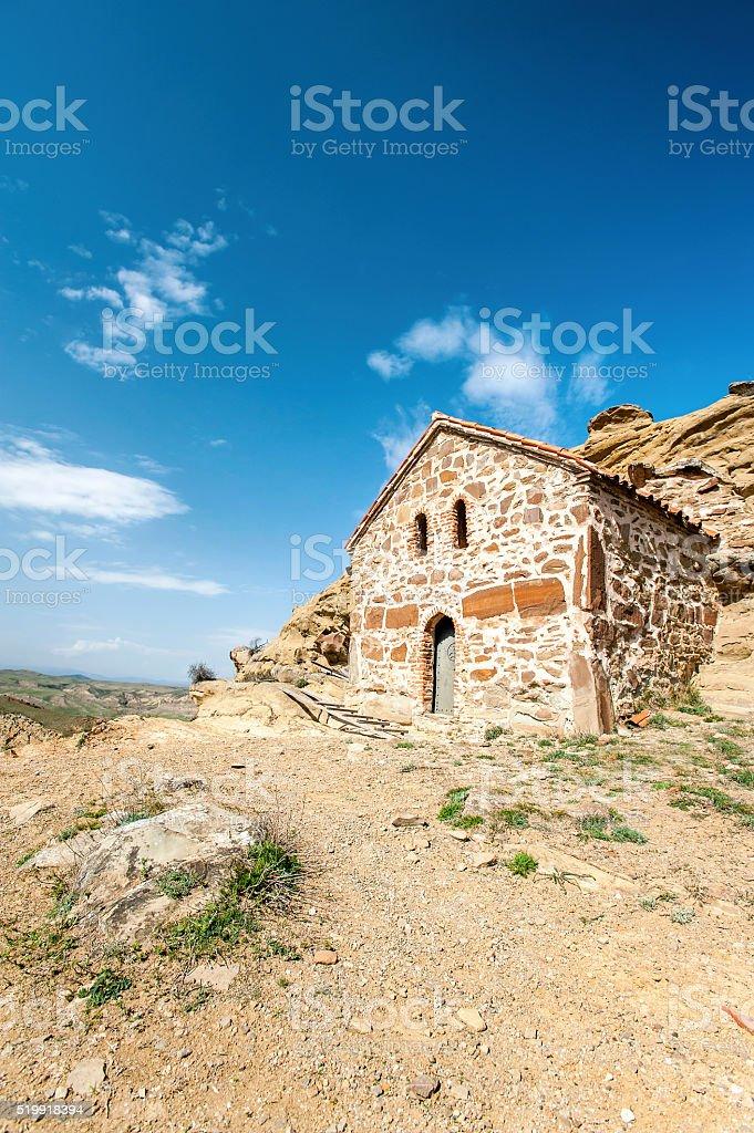 Antique historical church built in cliff in David Gareji monastery stock photo