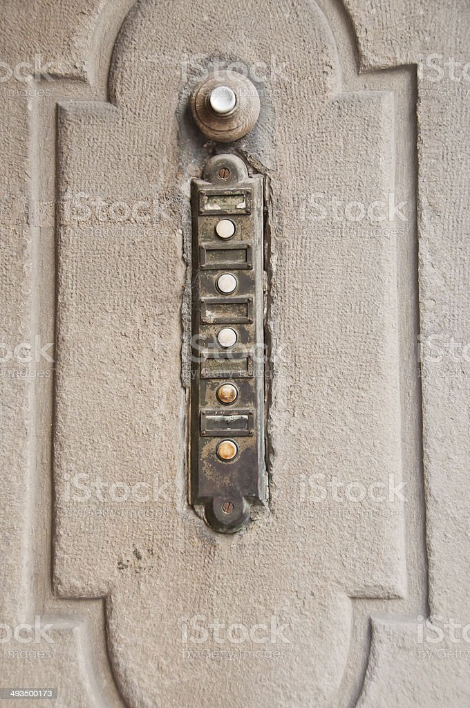 Antique iron doorbell with six buttons stock photo