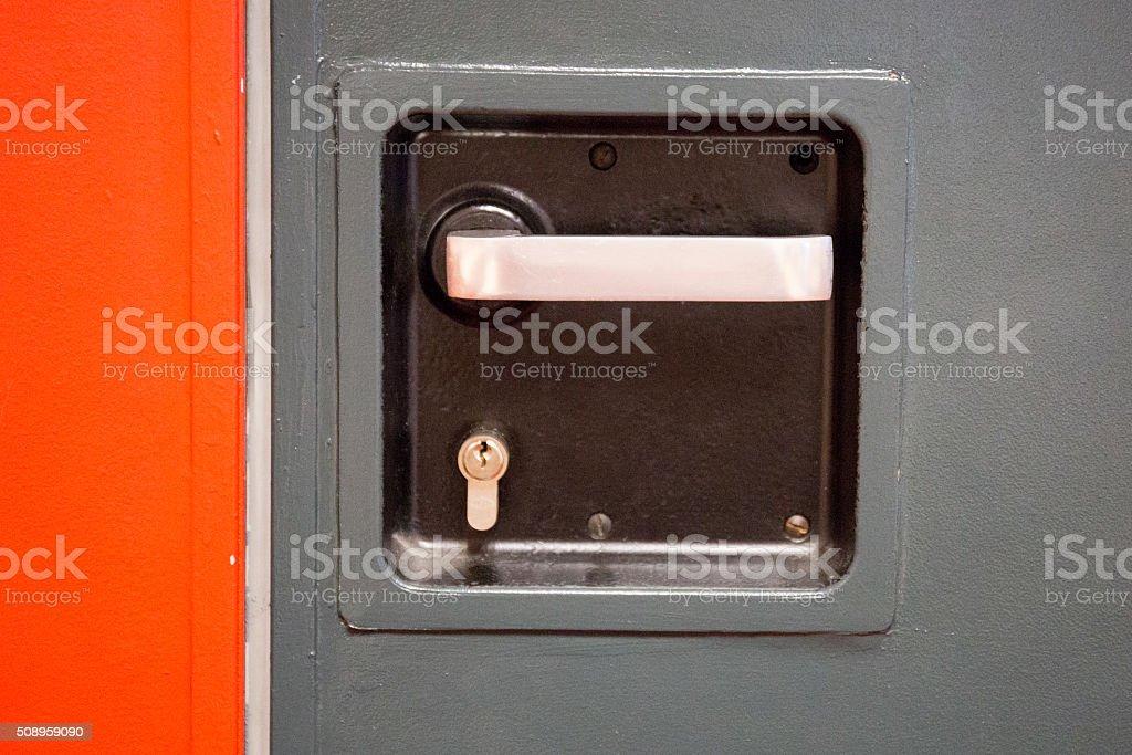 Antique iron safe isolated on green background stock photo
